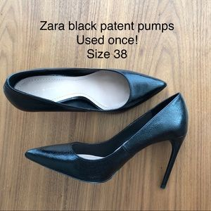 Black patent pointy pumps